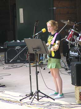 Girl playing bass guitar and singing