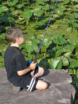 Child sitting on stone fishing (PDF)