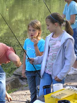 Children holding fishing pole (PDF)